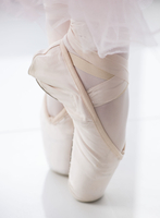 Feet of ballet dancer with ballet shoes