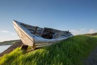 Abandoned boat on lakeshore