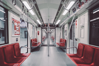 Interior of modern subway car with empty seats