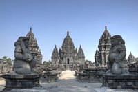 Ancient East Asian stone temple with statues