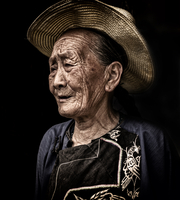 Portrait of elderly farmer woman in sun hat