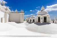 Terrace of historic building with white walls