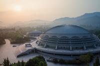 Exterior of modern stadium at sunset