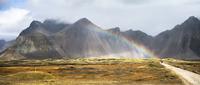 Rainbow against mountain landscape