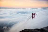 Golden Gate Bridge in clouds at dawn, San Francisco, California, USA