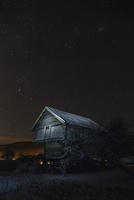 Starry sky over abandoned house