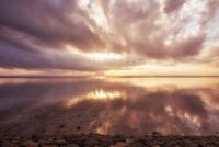 Sea coast at cloudy sunset