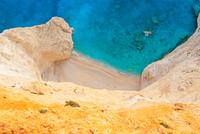 Sandstone cliff on sandy beach