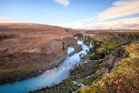 River flowing through volcanic terrain