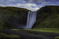Waterfall on green cliff