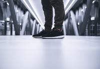 Sneakers on feet of man