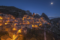 Old town on mountainside at night