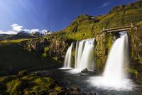 Waterfalls on green cliffs