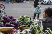 Market stand with vegetables in city
