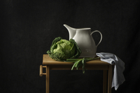 Studio shot of cabbage and jug on table