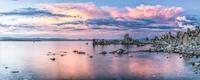 Sea coast at cloudy dawn