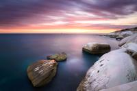 Sea coast rocks at dusk