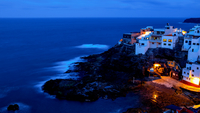 Old town on seashore at night