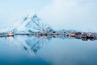 Town on seashore under mountain peak in winter