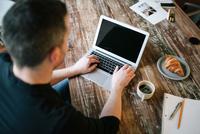 Office worker using laptop on coffee break