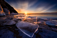 Ice floe on shore at sunset