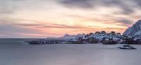 Scandinavian town on seashore at sunset