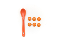 Plastic spoon and orange pebbles