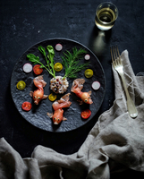 Decorated dish on black plate