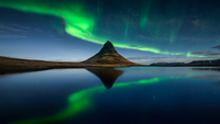 Green northern lights over Kirkjufell mountain, Iceland