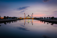 Mosque with minarets at sunset