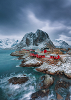 Scandinavian fishing houses on shore with snow