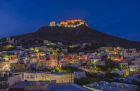 Old town at night with castle on hill