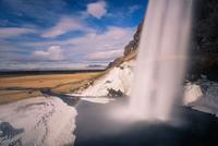 Seljalandsfoss and rainbow in long exposure, Iceland