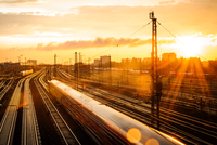 Railways and trains in city at sunset, Munich, Bavaria, Germany