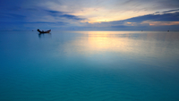 Sunset over Gulf of Thailand with boat silhouette, Surat Thani, Thailand