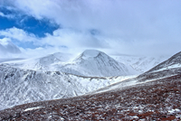 Snow capped Cairn Toul mountain in sunlight, Cairngorms, Scotland, UK