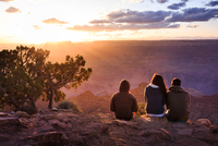 Friends watching sunset over Grand Canyon, Arizona, USA