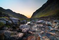 River at Llanberis Pass at sunset, Nant Peris, Llanberis Pass, Snowdonia, Wales, UK