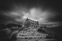 Stone chapel near Lake Tekapo under cloudy sky, South Island, New Zealand