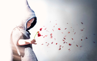 Little boy (2-3) in hooded robe holding flower with petals blowing in wind 11098072170| 写真素材・ストックフォト・画像・イラスト素材|アマナイメージズ
