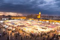 Illuminated city market at sunset, Marrakesh, Morocco