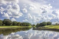 Blue sky reflected in pond, Londrina, Brazil