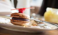 Chocolate macaron on white plate, London, England, UK