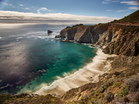 Cliffs and sandy beach seen from Pacific Coast Highway, California, USA