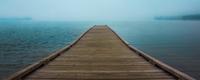 Misty Sebago Lake with pier, Maine, USA