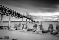 Pier and concrete construction on beach, Russia