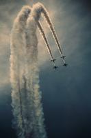 Vapor trails behind flying planes