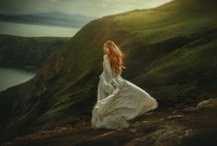 Long-haired woman in white dress, Ireland, UK