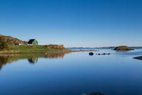 Green hut at ocean, Newfoundland, Canada