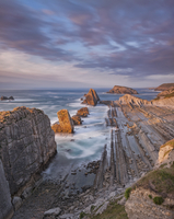 Playa del Portio rocky beach at sunset, Liencres, Cantabria, Spain